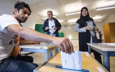 epa07007603 Electoral Counselor Rahim Hotek (L) puts an election envelope into a ballot box at a polling station in the Kroksbaecks School, in Malmo, Sweden, 09 September 2018. About 7.5 million Swedes are eligible to vote in the countryâs general elections on 09 September that are expected to see huge gains for the far-right Sweden Democrats (SD) party and losses for the ruling coalition of Social Democrtas and the Green party. The previous election campaign has been dominated by a controversial debate over the countryâs immigration policy.  EPA/JOHAN NILSSON SWEDEN OUT